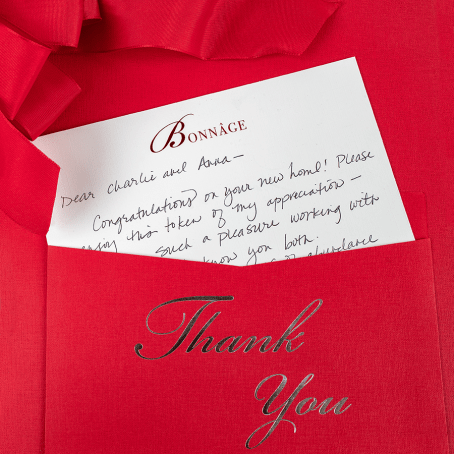 Thank you note in red envolope